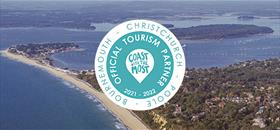 Overhead shot of Sandbanks and  Poole harbour with a circular logo overlaid