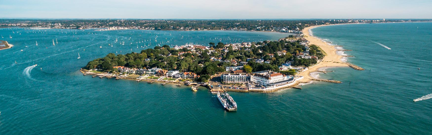 Aerial image of Sandbanks Poole showing the full landscape, the ferry is shown with Poole Harbour and Sandbanks Beaches.