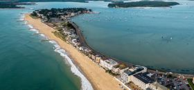 Beautiful birds eye shot of Sandbanks pristine beach with Poole harbor on the otherside