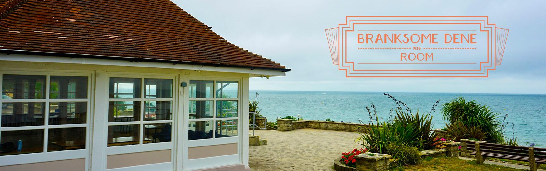 Stunning shot of Branksome dene room with beach in the background and the logo placed on top of the image