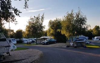 Sun setting over the caravans