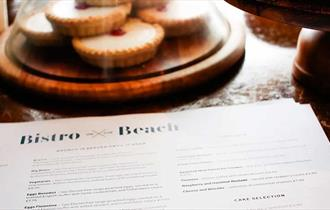 Food menu with tasty bake well tarts