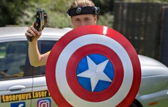 Girl holding a laser gun and target