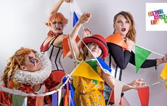 four people dresses as circus performers entangled in colourful bunting
