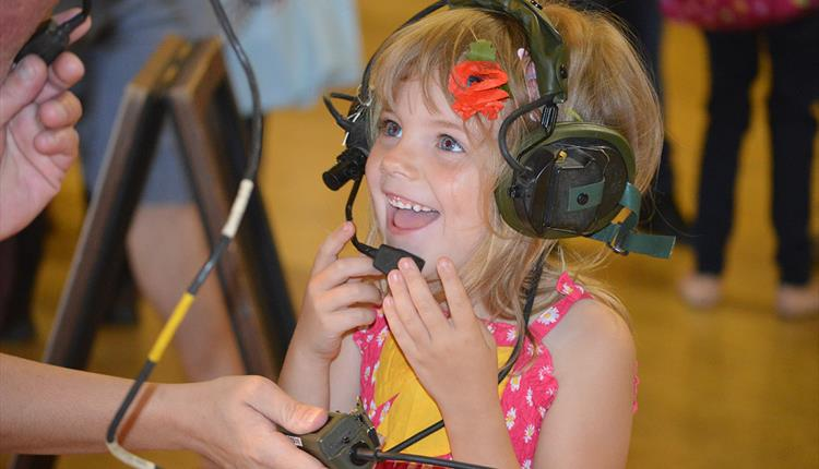 Young girl interacting with the communication equipment