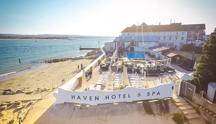 Ariel view of the Haven hotel and Spa with the beach next to it