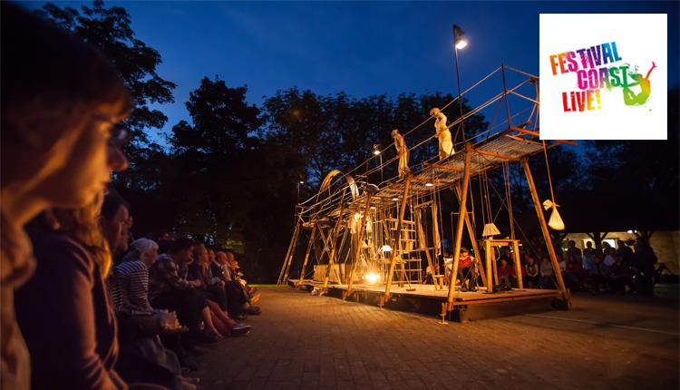 Stage outdoor performance with lights and an audience in the dark