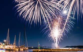 Bright Firework display over Poole Quay