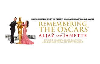 Man in black tux and woman in long sequin pink dress leaning up to Oscars golden trophy with text 'Remembering the Oscars' to the right