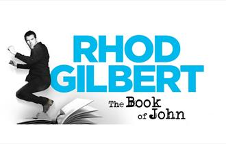 Rhod Gilbert jumping above an open page book with his name in bright blue, against black and white background