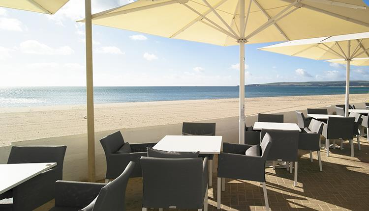 Outdoor eating area overlooking Sandbanks beach