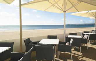 Outdoor eating area overlooking Sandbanks beach