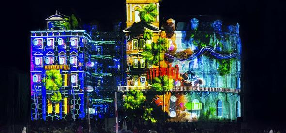 Bournemouth's town hall lit up by a projector showing amazing images and videos at night
