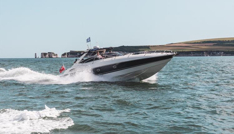 One of the boats cruising with OId Harry rocks in the background.