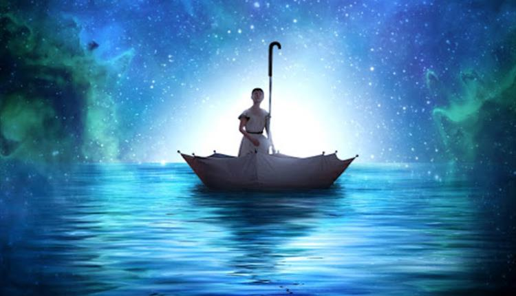 A figure floating ontop of blue and green water in an upturned umbrella. The sky is blue and green and filled with stars.