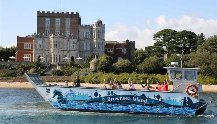 Brownsea Seahorse in front of the National Trust House