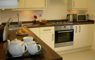 Inside of warm inviting kitchen with facilities