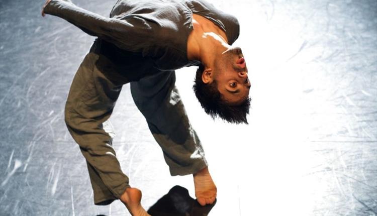 dancer on stage in a deep back bend