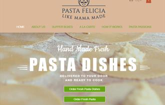 Image of a webpage that reads Home Made Fresh Pasta Dishes, with an image of pasta being prepared behind the text.