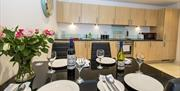 Dining table and kitchen at Crescent