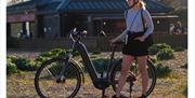 Girl with an eBike on Southsea Beach