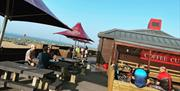 Outside seating and parasols at Eastney Coffee Cup