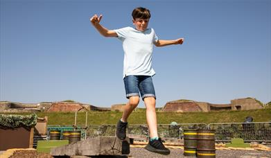Young boy playing on the Fort Nelson Assault Course