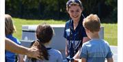 Paratriathlete gold medallist Lauren Steadman chatting with children