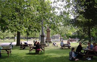People enjoying the benches at Victoria park