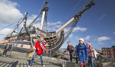 Children outside HMS Victory