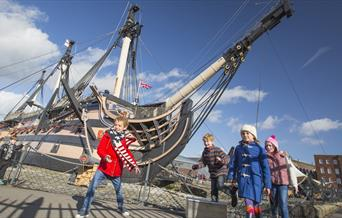 Children outside HMS Victory