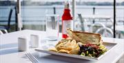 Enjoy a spot of lunch with a seafront view at The Waterfront Cafe