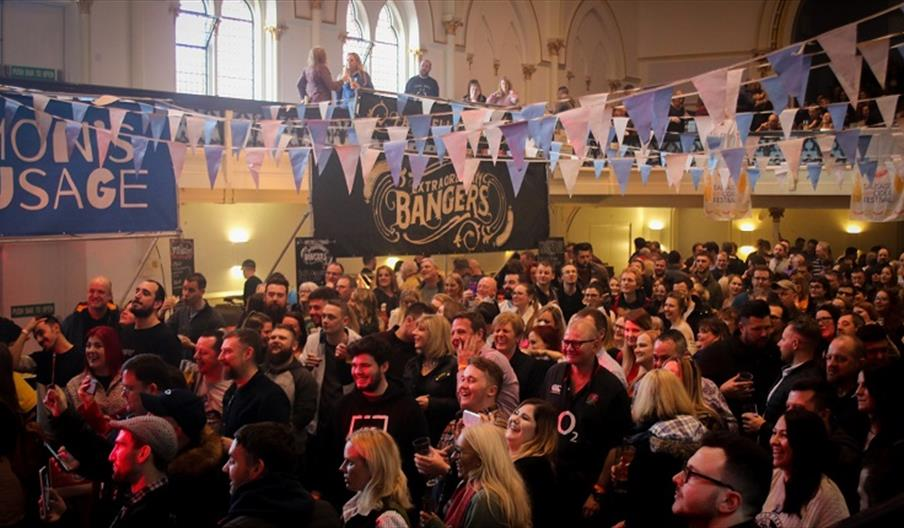 Crowds gathered at a Sausage and Cider event