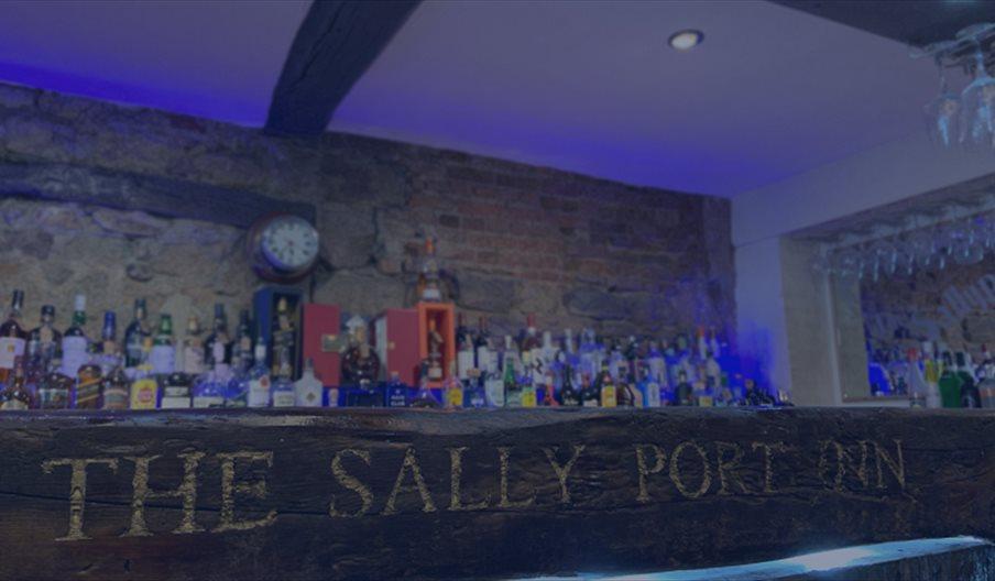 The well-stocked bar at the Sally Port Inn