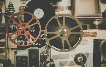 Stock image of film reels, for Sunset Drive-In Movie Nights