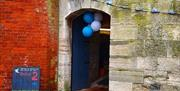 Balloons and bunting to welcome visitors through the archway into the Round Tower. Copyright Rachel James.