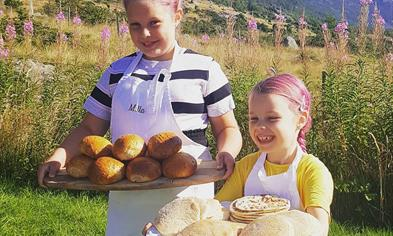Two girls serving pastries from the bakery.