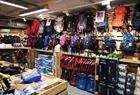 A large selection of backpacks and other items.