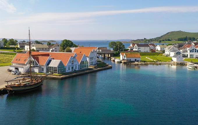 """The hotel is located in beautiful surroundings at Mosterøy island. The elegant replica of the original ship """"Restauration"""" is anchored up in front of"""