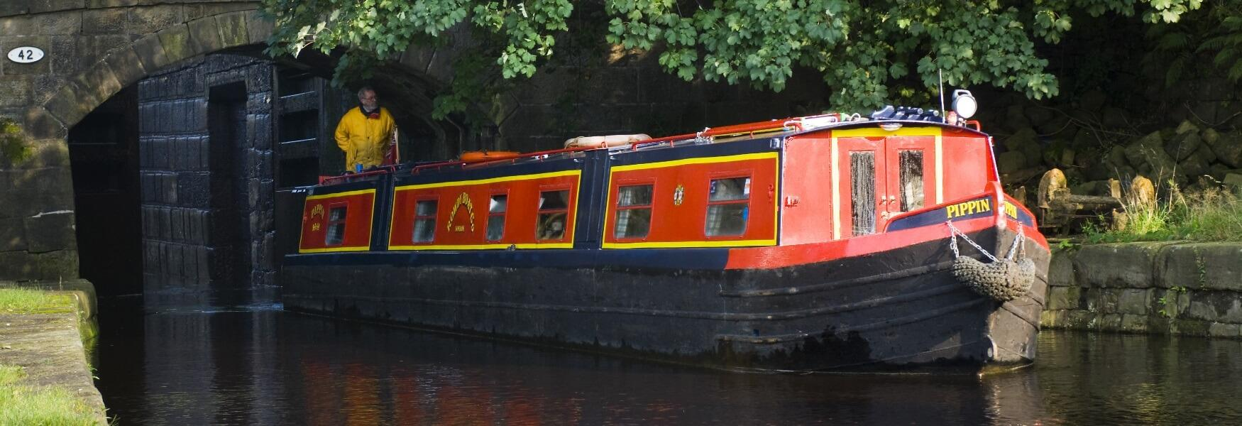 A barge sailing through the Summit Canal Lock.