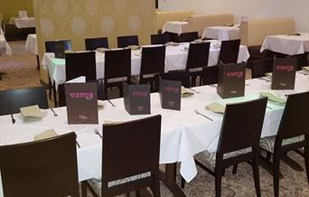 Tables and chairs laid out in the Venus Lounge main dining area.