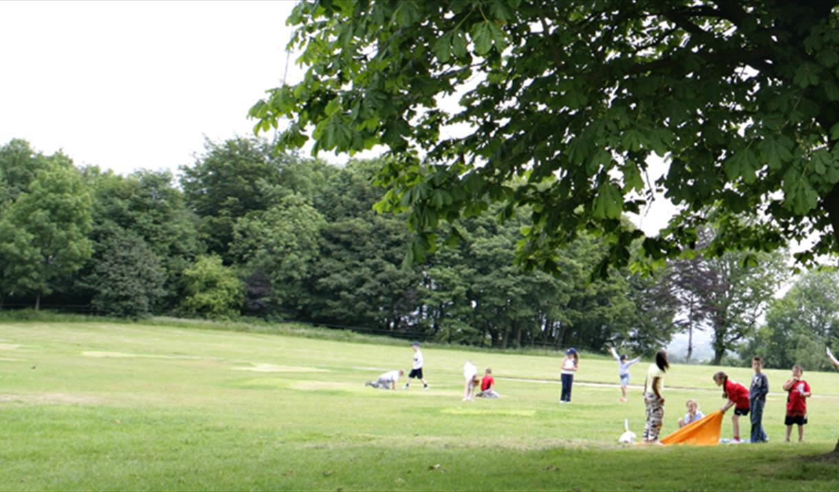 Families playing at Falinge Park.