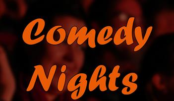 """*image with audience in the background, with the words """"The Watershed Comedy Nights"""" in the foreground"""", in white and orange text*"""