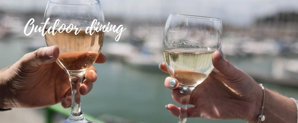 Waterfront Dining in Gosport by the Marina, glasses raised to celebrate.