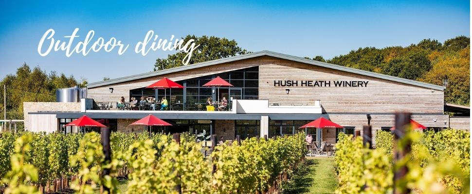 Enjoy alfresco dining on the large outside terrace at Hush Heath Winery with views across the estate.