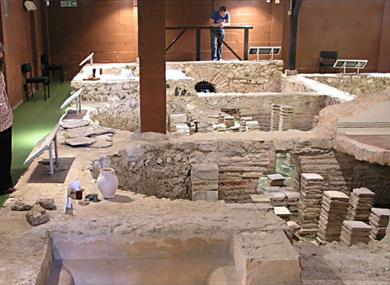 Lady viewing Roman bath at Newport Roman Villa, Isle of Wight, Things to Do