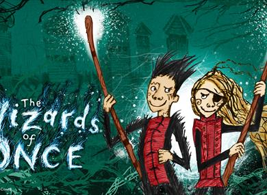 a green illustrated poster. To the left says 'The Wizards of Once'. To the right are character illustrations of boy and girl holding staffs. Girl has