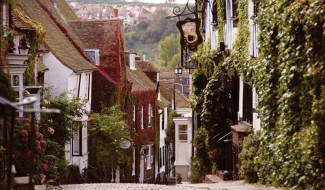 Mermaid Street in Rye town showing cobbles, pubs and timber-framed houses