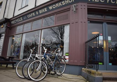 exterior of a store, with three bikes lined up outside