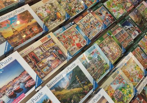 Shelves stacked with jigsaw puzzles